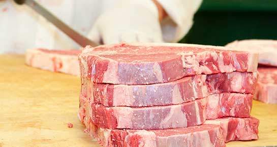 Vicente Foods Butcher cutting Steaks